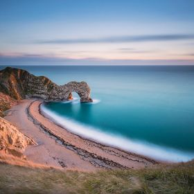 Durdle Door is a natural limestone arch on the Jurassic Coast near Lulworth in Dorset, England. It is privately owned by the Welds,a family who o...