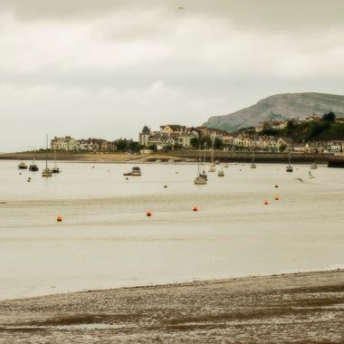 Deganwy on the banks of the River Conwy with the Great Orme behind.