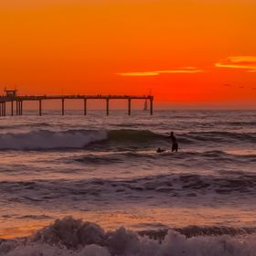 Paddling into the red horizon in Mission Beach