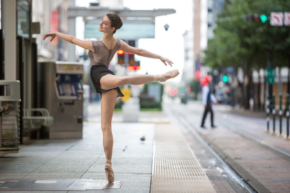 A ballerina performs at a metro station in downtown Houston.