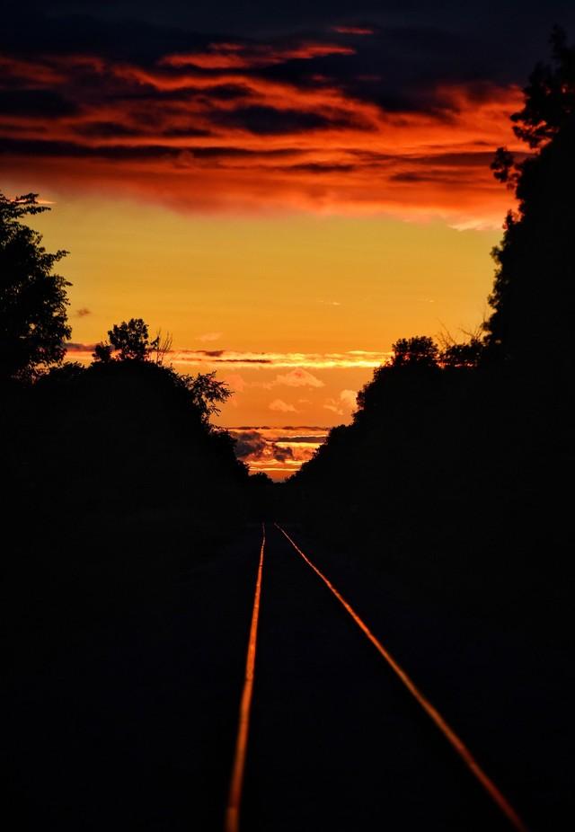 Orange Sunset upon railroad tracks