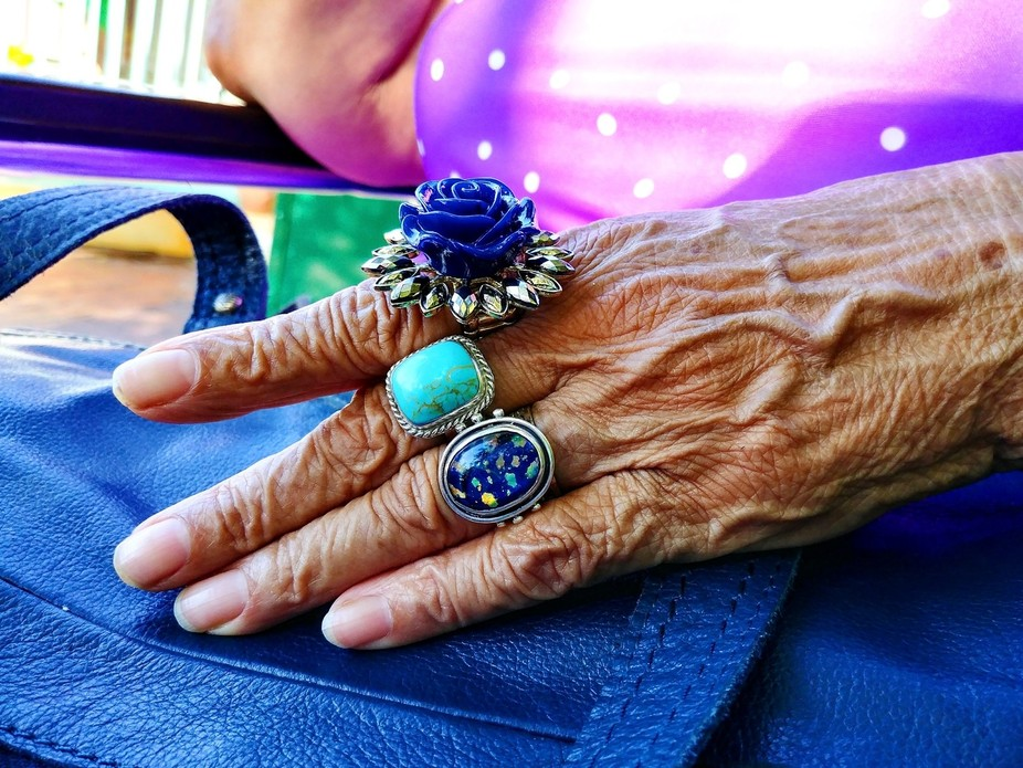 My mother loves colorful rings and trinkets. She was wearing a colorful outfit and I liked the wa...