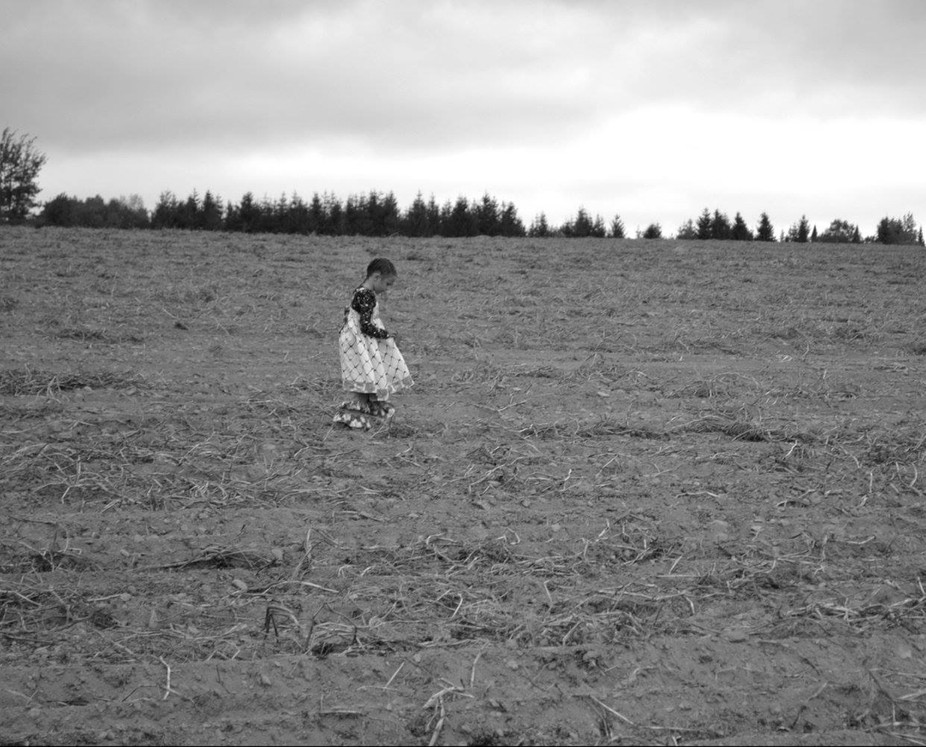 My daughter in the fields harvesting potatoes at home in Northern Maine