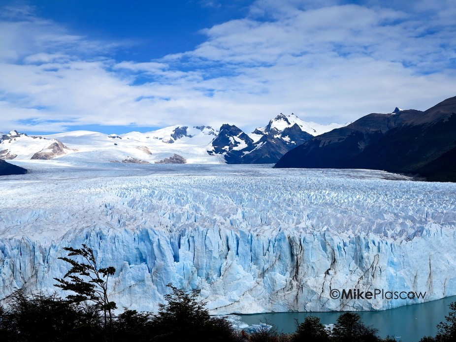 Worlds third largest ice field between Argentina and Chile-Patagonia -  sun shining on blue sea r...