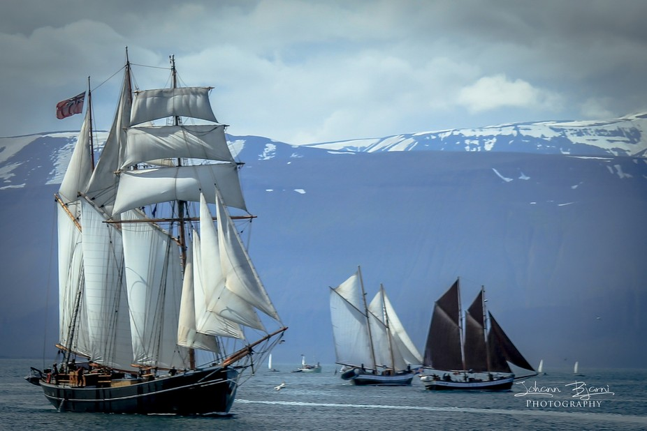 Ships sailing on Skjalfandi bay in the north east of Iceland during a town festival in the end of...
