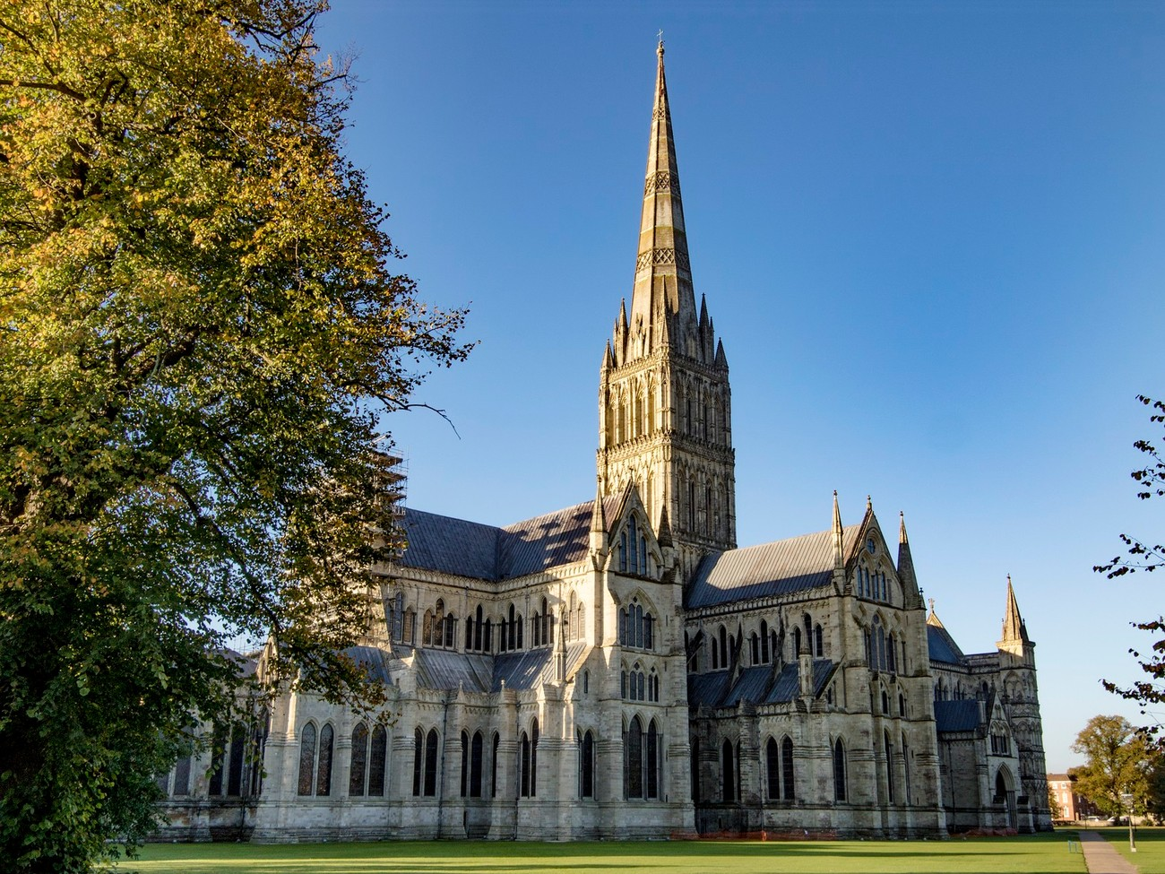 Salisbury Cathedral was built during the 12th and 13th centuries AD at its current location in the centre of Salisbury, UK. An earlier cathedral existed at Old Sarum castle a few miles away. The cathedral spire is the tallest spire in Europe  but was an addition to the original plan in the 13th century. Today it looks as if it is sloping to one side, which it is. This is because the tower it was placed on was not constructed to carry the weight of the spire.
