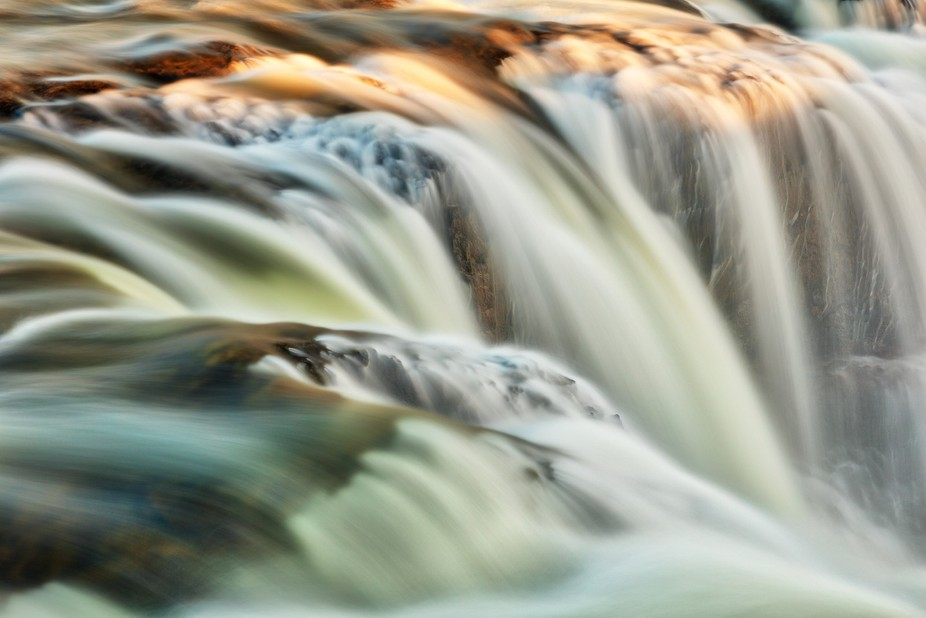Close-up long exposure photo of Kolufoss waterfall, Iceland. Colors enhanced to make the image po...