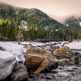 Clouds and sunlight over Nisqually River at Mt Rainier National Park