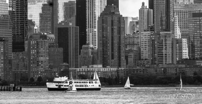 NY in Summer with cruise boat