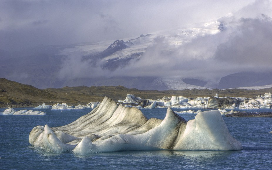 An iceberg floats through a glacial lagoon on its way to the north Atlantic, in southeastern Icel...