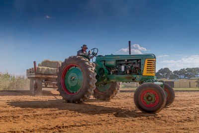 Farmer brown on his green tractor.