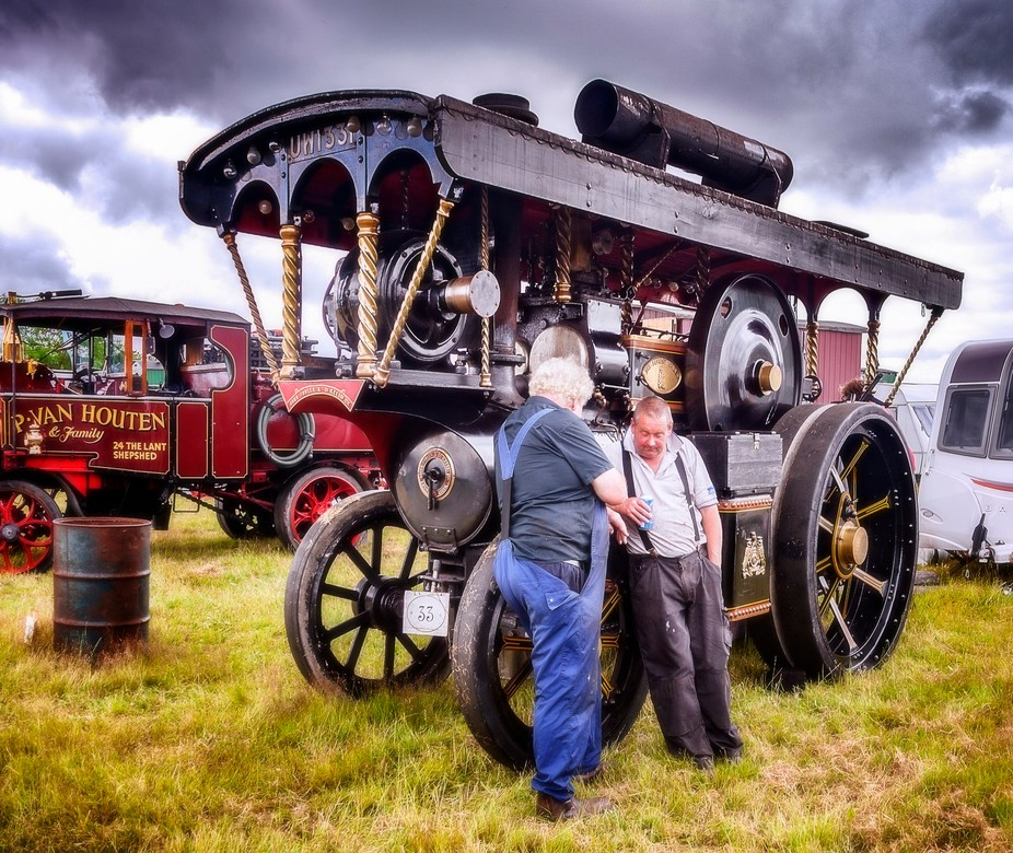 Two enthusiasts chatting at the Hollowell Steam and Heavy Horse Show in Northamptonshire