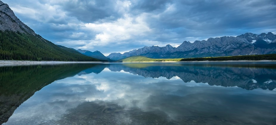 Kananaskis Lake is a natural lake that was turned into a reservoir in Kananaskis Country in Alber...