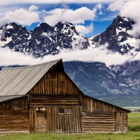 Clouds gather over the Teton Range behind the T.A. Moulton barn, on Mormon Row in Grand Teton National Park.