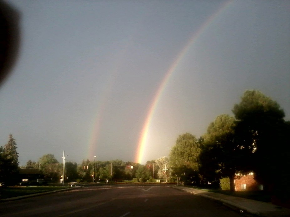 It was a day of pouring rain, Then out came the sun along with two rain bows.