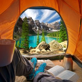 Two shot composite of my shot of lake Louise and another of myself inside a tent.