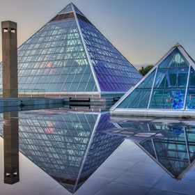 A nice shot during sunset of the Muttart Conservatory in Edmonton, Alberta.   After the rain the roof of this place fills up with these huge pudd...