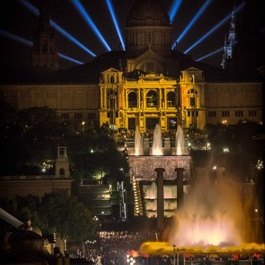 The Magic Fountain of Montjuïc is a fountain located at the head of Avinguda Maria Cristina in the Montjuïc neighborhood of Barcelona, Catalonia, Spain. The fountain is situated below the Palau Nacional on the Montjuïc mountain and near the Plaça d'Espanya and Poble Espanyol de Barcelona. The fountain, like most of the surrounding developments, was constructed for the 1929 Barcelona International Exposition.  The Magic Fountain was designed by Carles Buïgas, who had designed illuminated fountains as early as 1922. The site where the fountain was constructed was the previous location of The Four Columns. The columns, representative of the Catalanism movement, were demolished in 1928 under the orders of Prime Minister Miguel Primo de Rivera and were re-erected in 2010 a few meters away from the original location.