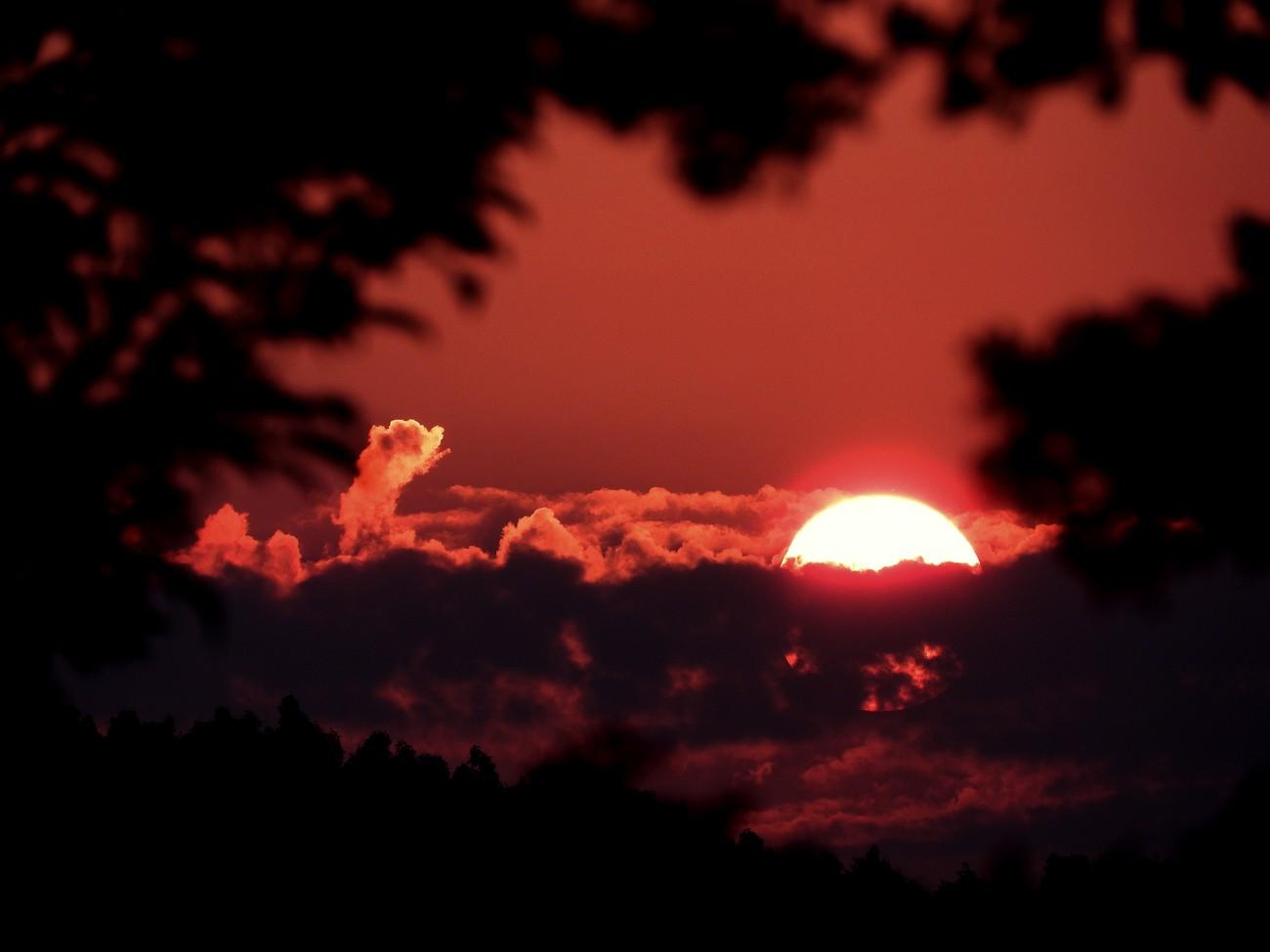 last shot as sun rose above the cloudy horizon
