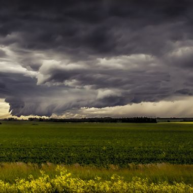 Coming across Canada's great Prairies, low funnel gather as the storm get ready to break open.