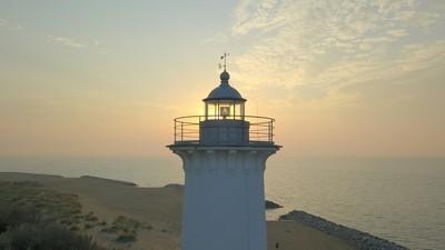Lighthouse of raising sun