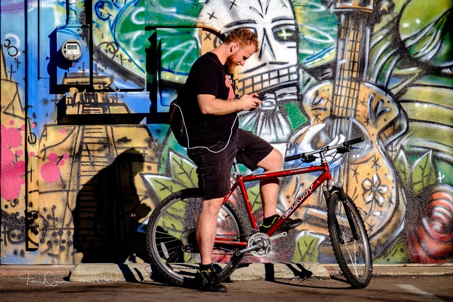 While photographing urban landscapes in Phoenix, I came across this man on his bike in front of s...