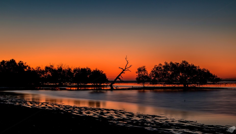 Sunset at Bushland Beach, Townsville, Qld AU.  I was shooting the rising moon with a reverse suns...