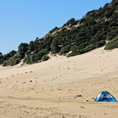 I took this photo when me and my family went to the Karpas Peninsula and stayed there for a couple of days in the year 2013. While we were walking on the beach we came to this tent and I took this photo.