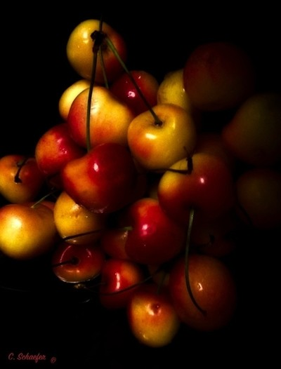 Cherries in a pile up.