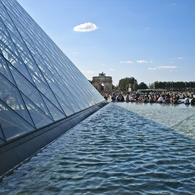 I took this photo when we went on a holiday to Paris, in the year 2009.  This photo was taken next to the Louvre's glass pyramid.