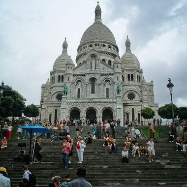 I took this photo when we went on a holiday to Paris, in the year 2009.  This photo was taken in front of the Sacred Heart Basilica of Montmarte.