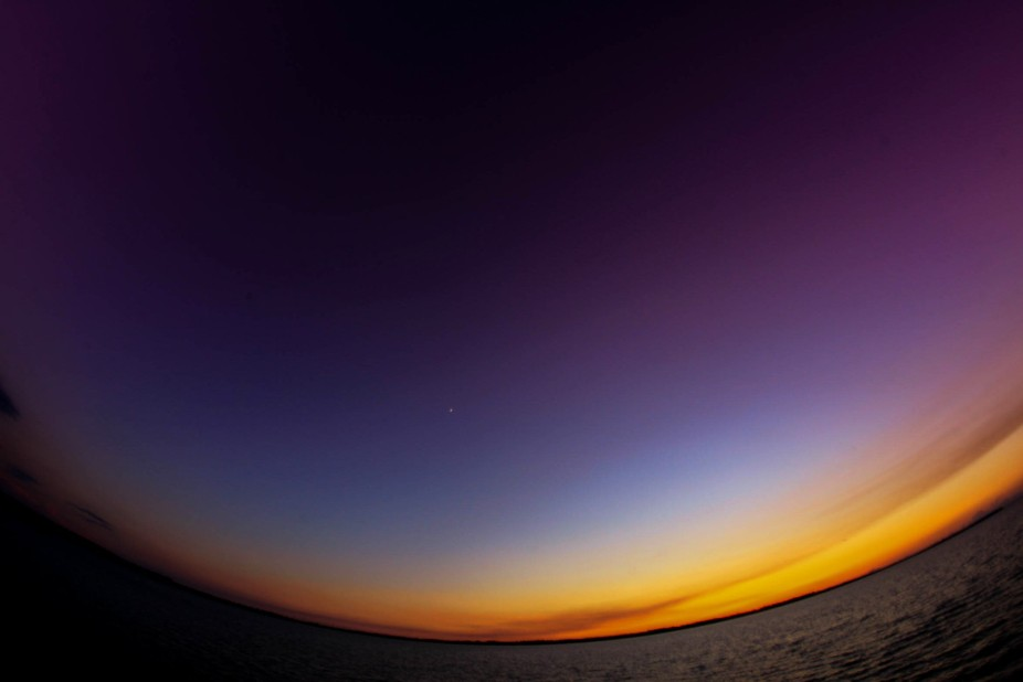 I experimented a different way of taking a shot of the sunset setting down on the horizon by usin...