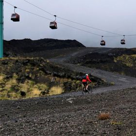 Mount Etna and brave cyclists.