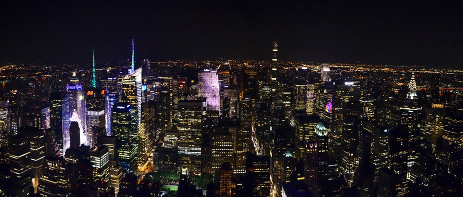 Took this shot from on top of the Empire State Building.  What a beautiful NYC night!