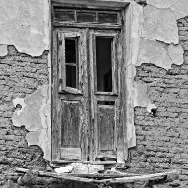 I took this photo at Çınarlı Village,in the year 2013. This door used to open to a balcony but now it is in ruins.