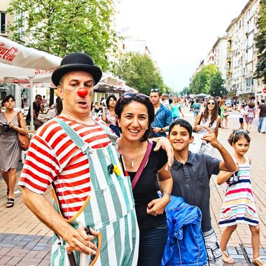 I took this photo when me and family were walking along one of the most visited shopping areas in Sofia, Bulgaria in the year 2014. This clown approached us and wanted me to take a photograph of him with my wife. However, he also squirted water all over me as I was taking this photo.