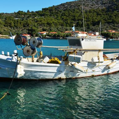 A very old Greek fishing boat moored in Posidonio Bay.