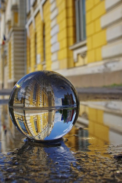Sphere glass ball in the puddle.