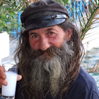 A friend and fisherman in Greece drinking Ouzo 'Yammas'