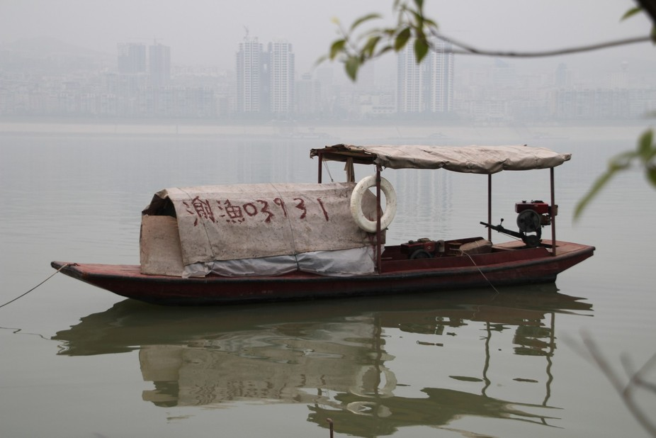 Farmer's boat transporting goods to local market on Yangtze River, China