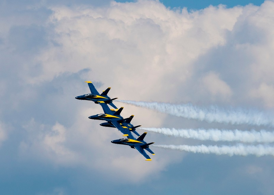 I took this photo at the EAA AirVenture 2017 outing.  I really liked the Blue Angles with the fan...