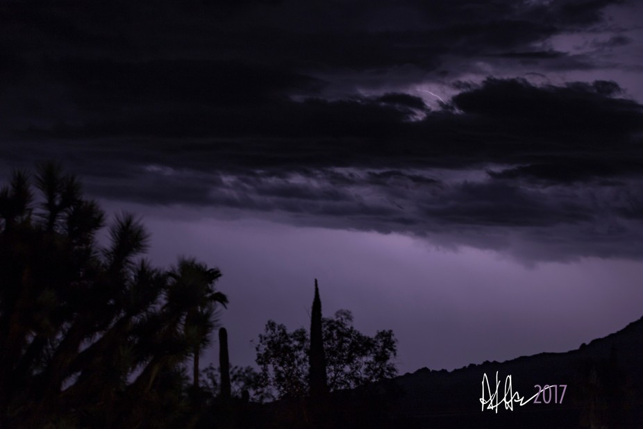 silhouettes get exposed by intense night cloud lightning