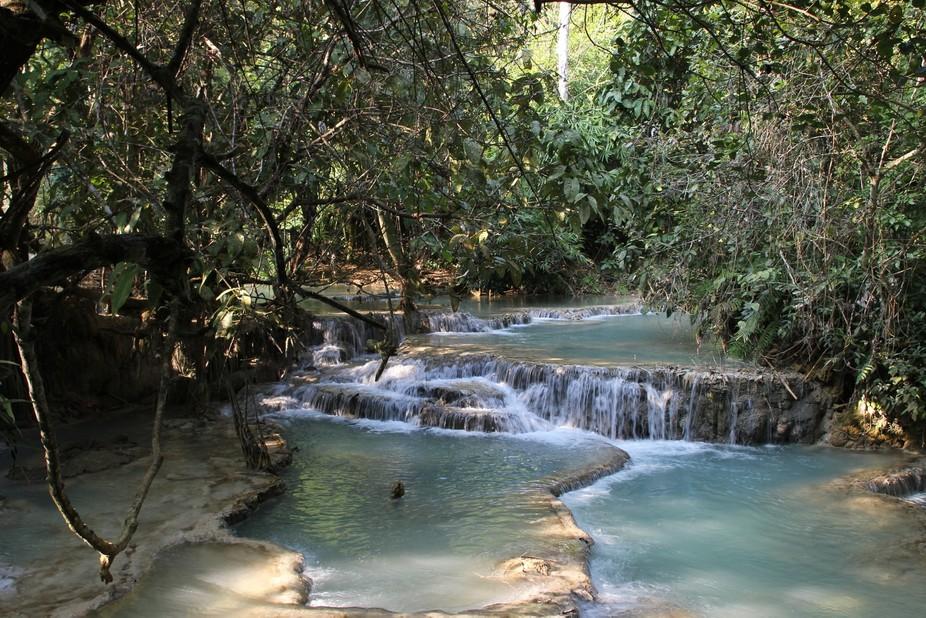 Kuang Si Waterfall is a stunning multi-tiered waterfall near Luang Prabang, Laos