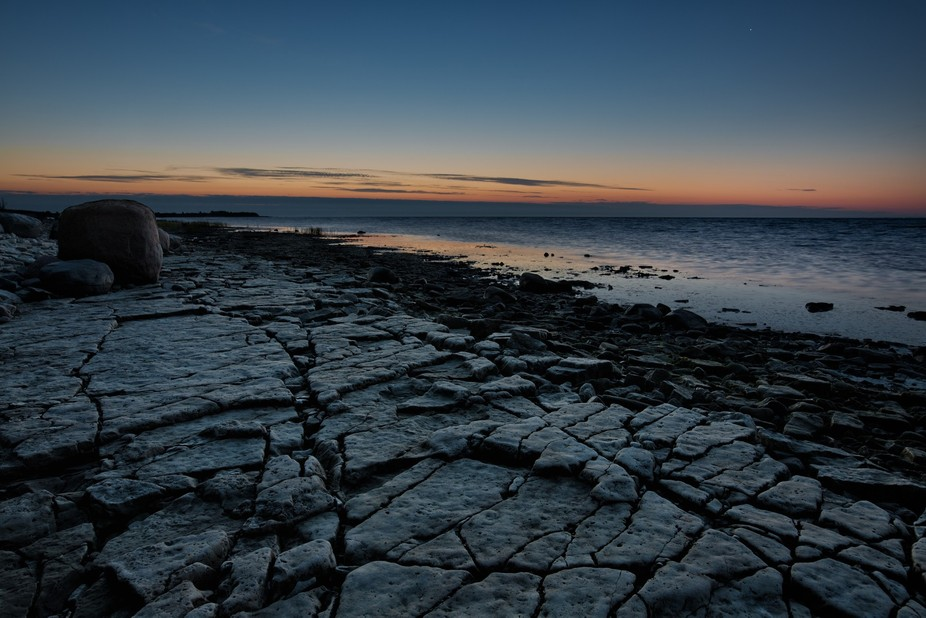 Cracked and washed limestone lit by the glowing dawn about an hour before the sunrise (Kübassaar...