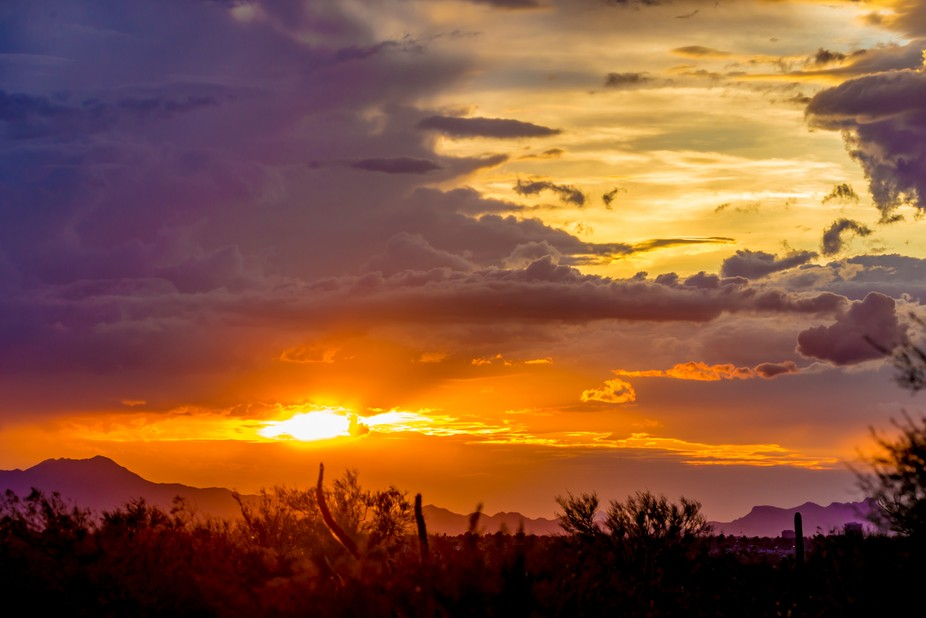 A monsoon weather sunset peeks through just for a moment