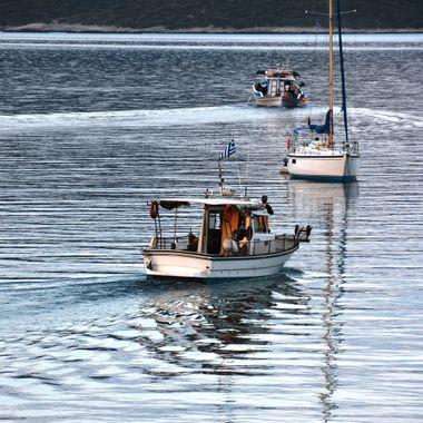 Fishing boats leaving Posidonio bay in Samos.
