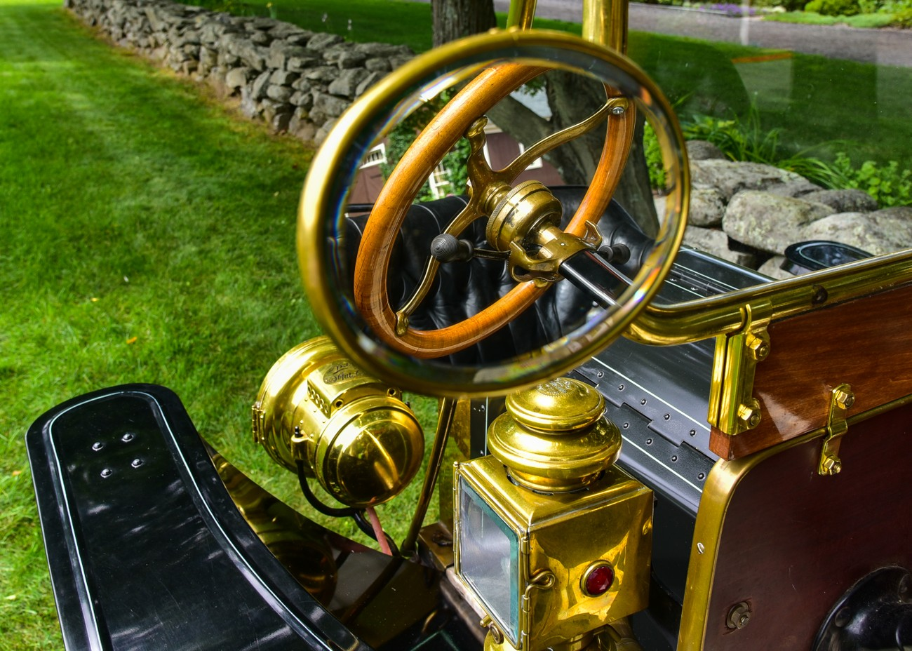 """""""brass era"""" of automobiles - the mirror on a Ford-T"""