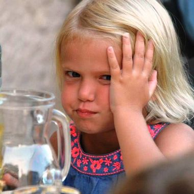 Little girl on holiday in Italy, not amused.