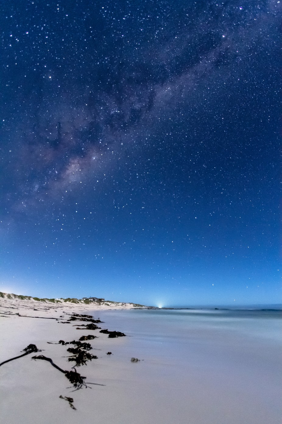 Pearly beach night lights by Cokies004 - Capture The Milky Way Photo Contest