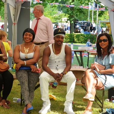 A family enjoying the Summer Fete.